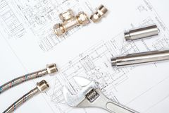 Plumbing and drawings, construction still life Stock Photography