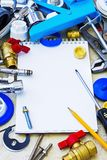 Plumbing equipment and notebook Royalty Free Stock Photography