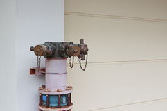Plumbing fire hydrant in a metal line wall. Fireplug with valves stock photography