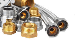 Plumbing fitting and hosepipe Royalty Free Stock Images
