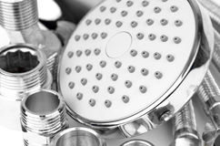 Plumbing fitting, hosepipe and showerhead Royalty Free Stock Images