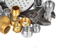 Plumbing fitting, showerhead and wrench Stock Image