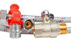 Plumbing fitting, tap and hosepipe Stock Photo