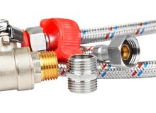 Plumbing fitting, tap and hosepipe Royalty Free Stock Image