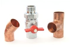 Plumbing fittings. And water valve isolated on white Stock Photo