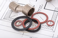 Plumbing fittings and gaskets. On a plan Stock Image