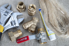 Plumbing fittings and tools Royalty Free Stock Photo