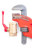 Plumbing fixture and adjustable wrench close up isolated Royalty Free Stock Images