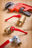 Plumbing fixtures and monkey wrench Royalty Free Stock Photos