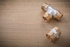 Plumbing fixtures pipe fittings on water mesh Stock Photo