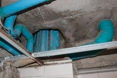 Plumbing fixtures PVC cement under the ceiling. Stock Photos