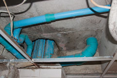 Plumbing fixtures PVC cement under the ceiling. Royalty Free Stock Images