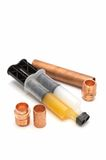 Plumbing gear. Copper pipe fittings and copper epoxy joining compound Royalty Free Stock Photo