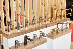 Plumbing and kitchen faucets at exhibition in store. Plumbing and kitchen faucets at the exhibition in the store Royalty Free Stock Photos