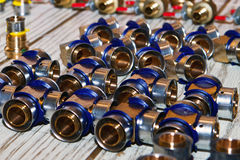 Plumbing materials. Plumbing supplies - Pipe fittings, connectors, couplings valves, adapters etc. - laid out before a pipefitting job Royalty Free Stock Image