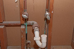 Plumbing - Old Bathroom Pipes Stock Photo