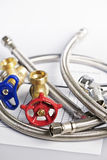 Plumbing parts. Plumbing valves hoses and assorted parts with estimate sheet Stock Photo