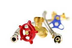 Plumbing parts. Isolated plumbing valves hoses and assorted parts Stock Image