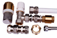 Plumbing parts on a white Royalty Free Stock Images