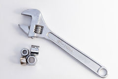 Plumbing pipe and adjustable spanner monkey wrench Stock Photography