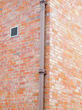 Plumbing pipe against stucco wall Stock Image