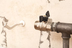 Plumbing pipe with valve for installation of a radiator Royalty Free Stock Photos