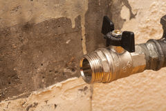 Plumbing pipe with valve for installation of a radiator Royalty Free Stock Photo