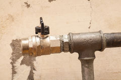 Plumbing pipe with valve for installation of a radiator Royalty Free Stock Image