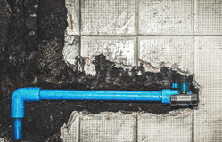 Plumbing pipe in the wall Royalty Free Stock Image