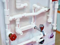 Plumbing plastic pipes and metal tap on exhibition Royalty Free Stock Image