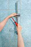 Plumbing repair,  install showerhead slide rail bar with soap di Stock Images