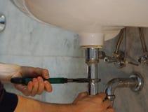 Plumbing repair service. Professional plumbing repair service with spanner Stock Photo