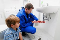 Plumbing repair sink Stock Photo