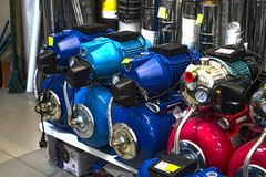 Plumbing shop. Rack with goods. Compressors and water pumps. Submersible pumps. Big choice