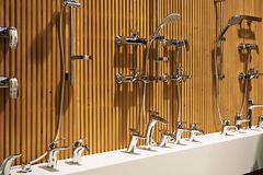 Plumbing shower faucets in store. Plumbing shower faucets at the exhibition in the store Royalty Free Stock Photography