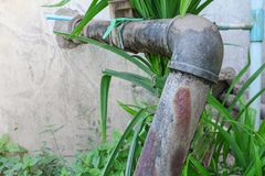 Plumbing Steel dilapidated old rusty industrial tap pipe Stock Images
