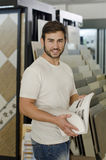 Plumbing, tile, ceramic  and furniture store clerk or client pos Stock Photography
