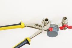 Plumbing tool near stopcocks Royalty Free Stock Photography