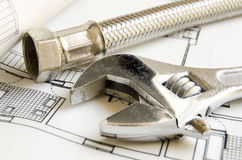 Plumbing tools. On house blueprint Royalty Free Stock Photography