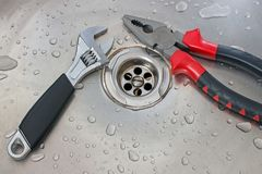 Plumbing tools adjustable wrench and pliers Royalty Free Stock Photography