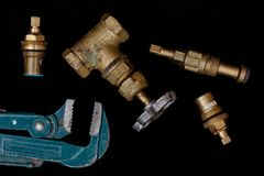 Plumbing tools on a black background royalty free stock image