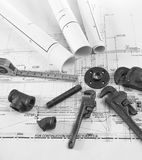 Plumbing tools on blueprints 1. Black and white photo of plumbing tools on blueprint Stock Photos