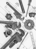 Plumbing tools on blueprints 2. Black and white photo of plumbing tools on a blueprint Royalty Free Stock Images