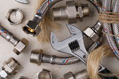 Plumbing tools for connecting water taps. Background. Top view Royalty Free Stock Images