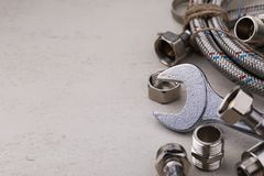 Plumbing tools for connecting water taps. With space for text Royalty Free Stock Photos