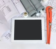 Plumbing tools on the construction drawings Stock Photos