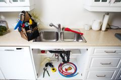 Plumbing tools on the kitchen. Stock Photos