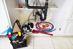 Plumbing tools on the kitchen. Renovation background royalty free stock photos