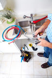 Plumbing tools on the kitchen. Royalty Free Stock Photo