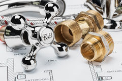 Plumbing and tools lying on drawing Royalty Free Stock Photography